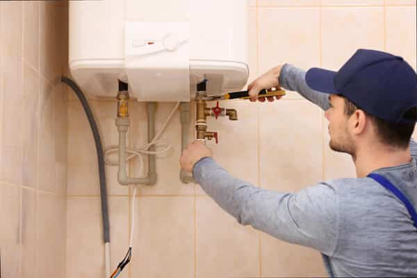 Plumber fixing and completing a gas system repair