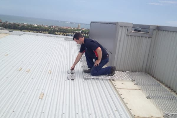 Man completing a roof repair
